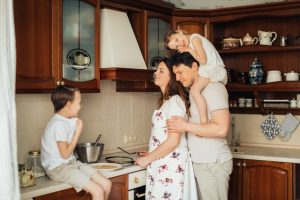 family preparing crepes together